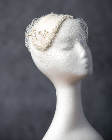 Bridal bandeau headpiece, pearl and feather embellishments on ivory sinamay.