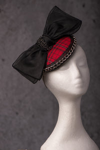 Tartan base with black bow and chain.