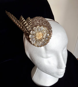 Pheasant and sequin headpiece.