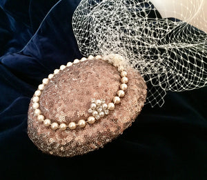 Sequin and pearl pillbox style headpiece with birdcage.