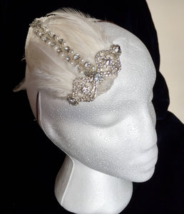 Diamante and ivory feather bridal headpiece.