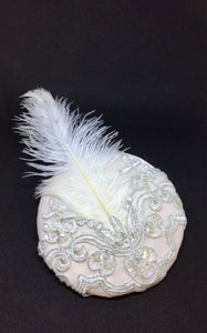 Bridal headpiece with ostrich feather.