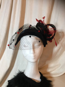 Black and red diamond headpiece with birdcage.