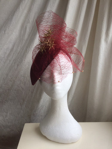 Wine velvet and gold headpiece.