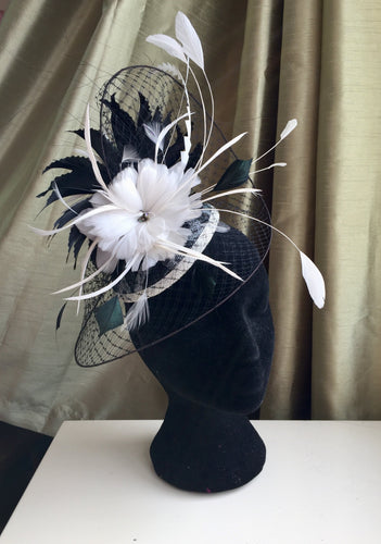 black and white hat, headpiece, with feather flowers, coq feather details and a veil brim. perfect for a monochrome outfit for a wedding, special occasion or horse racing event