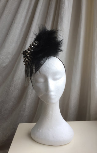Stud and feather rock chick headpiece.