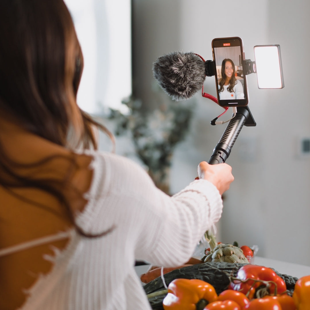 girl vlogging in kitchen on iphone using mobile creator kit from lume cube
