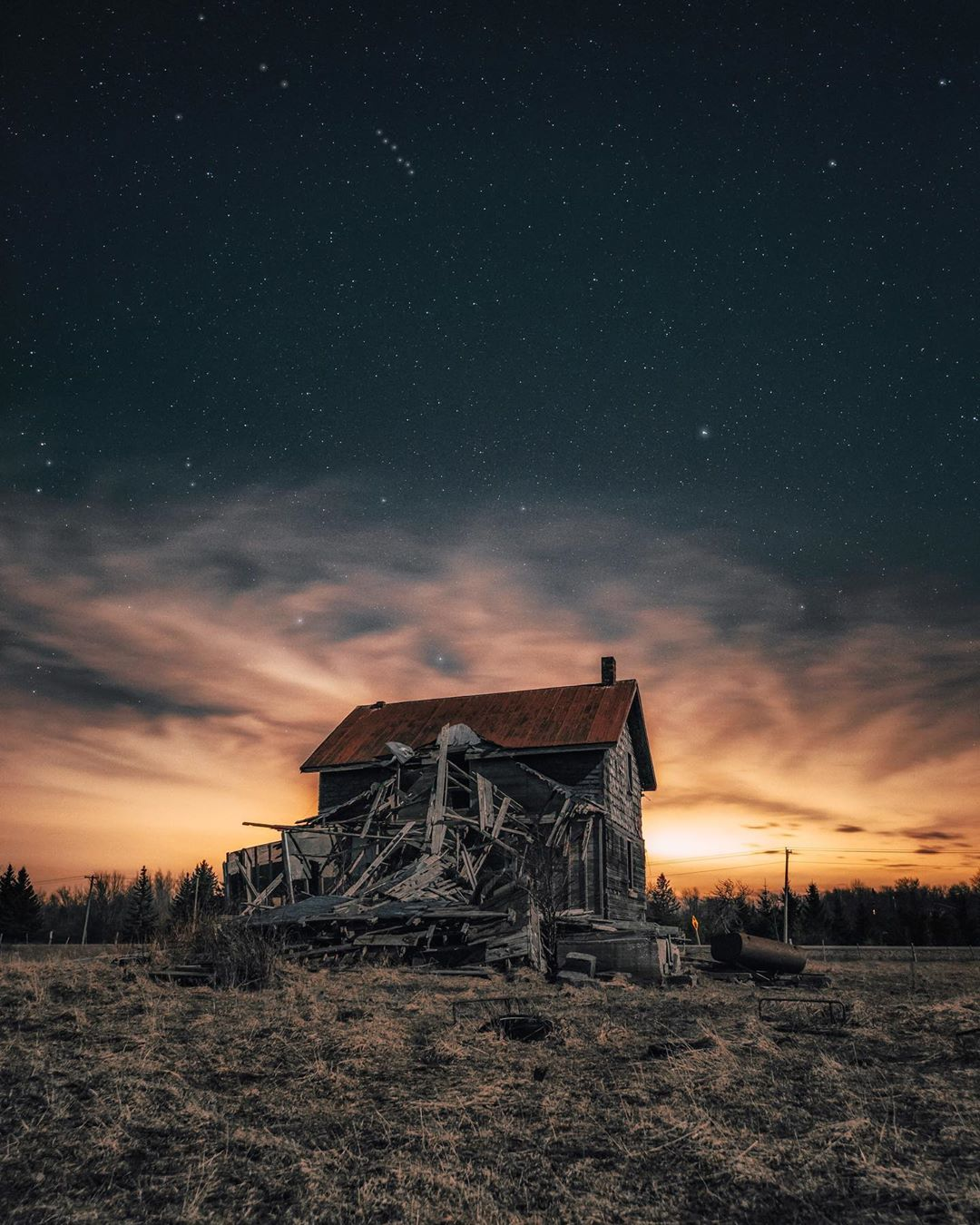 abandoned house with cloudy storm sky above