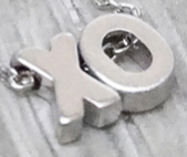 023 ($38) Earrings - XO - Silver