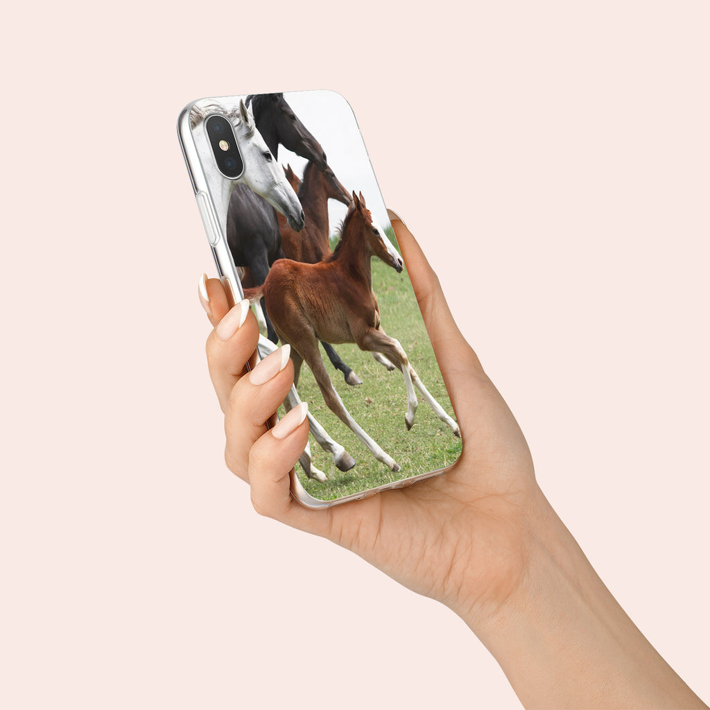 iPhone XS case with Wild Horses design made by Life By Design Creations  hand held view