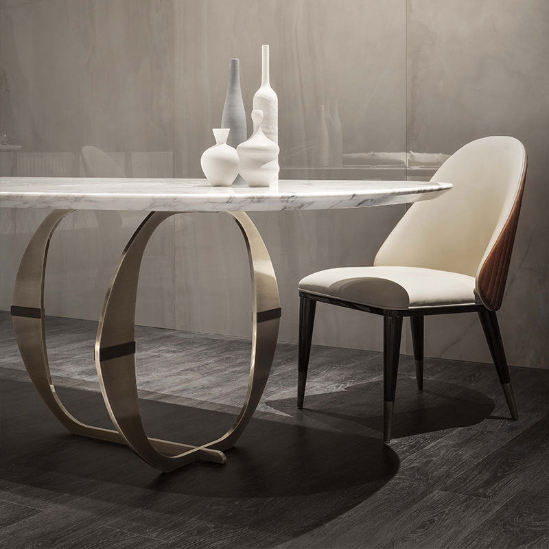 gold legs marble dining table with contrasting design chair