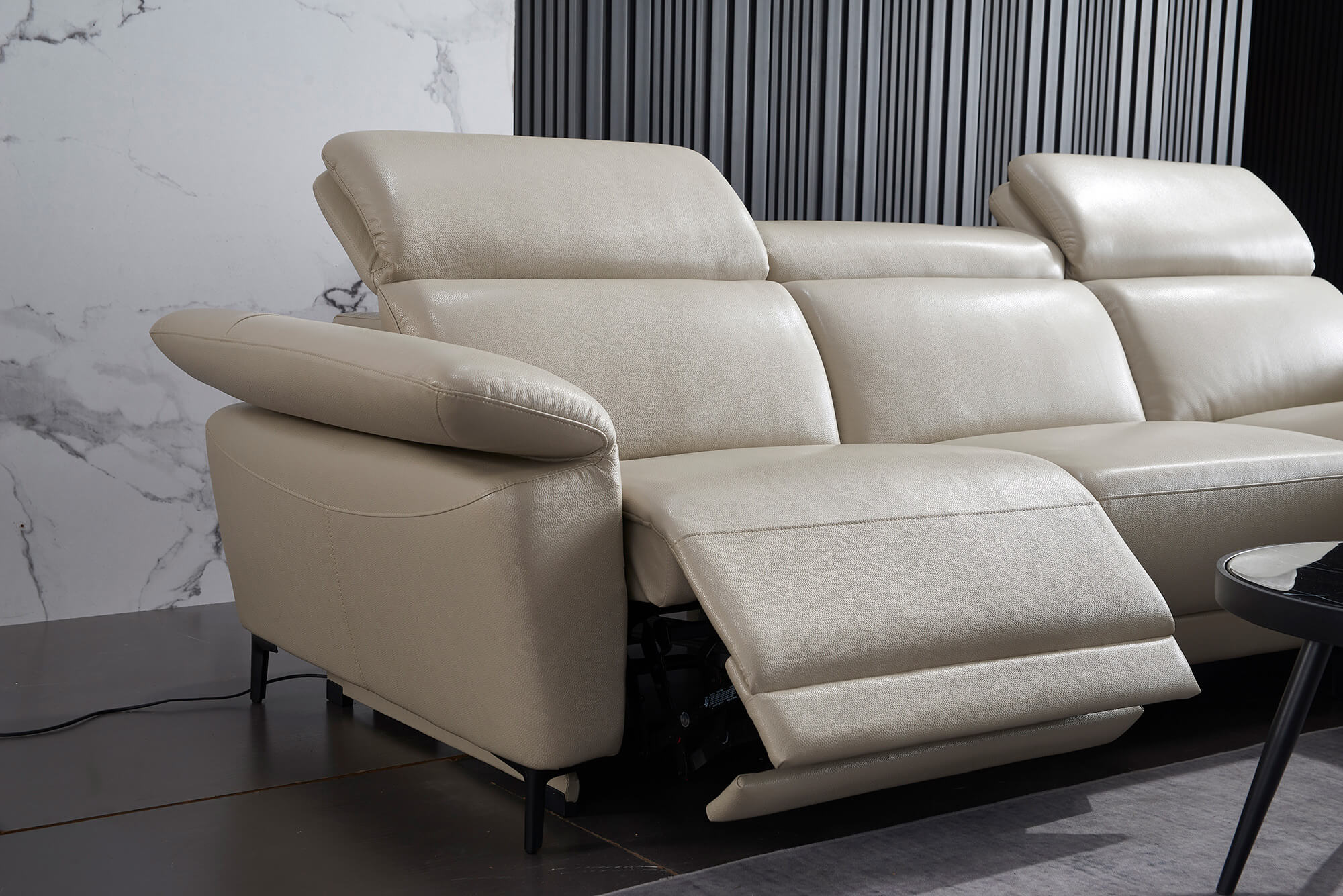 cream leather l shaped electric recliner reclined closeup