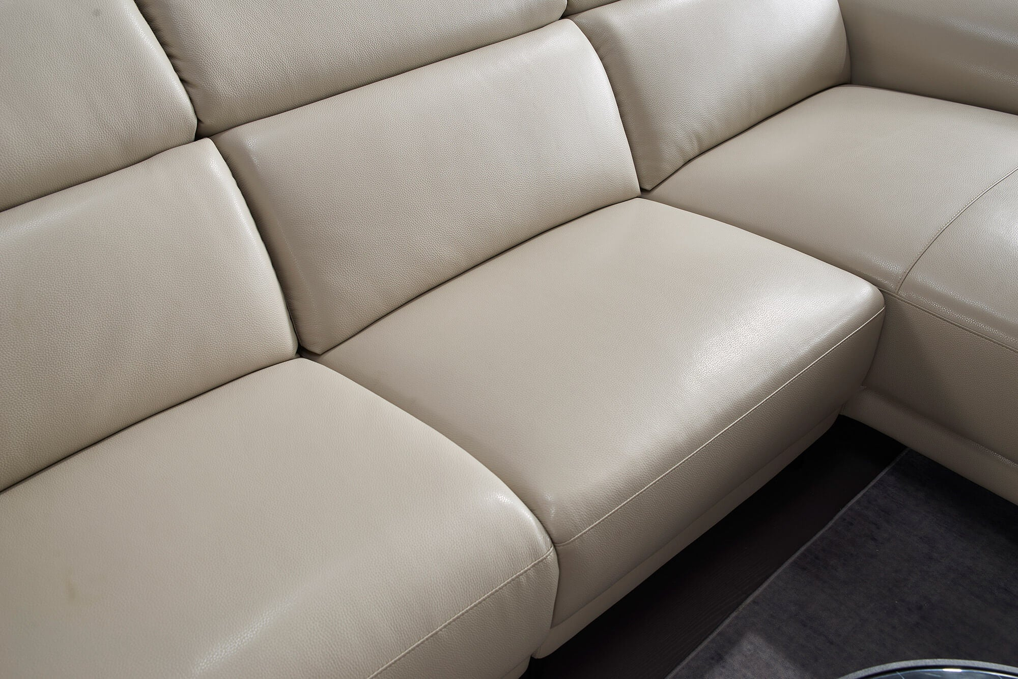 cream leather l shaped electric recliner seat closeup