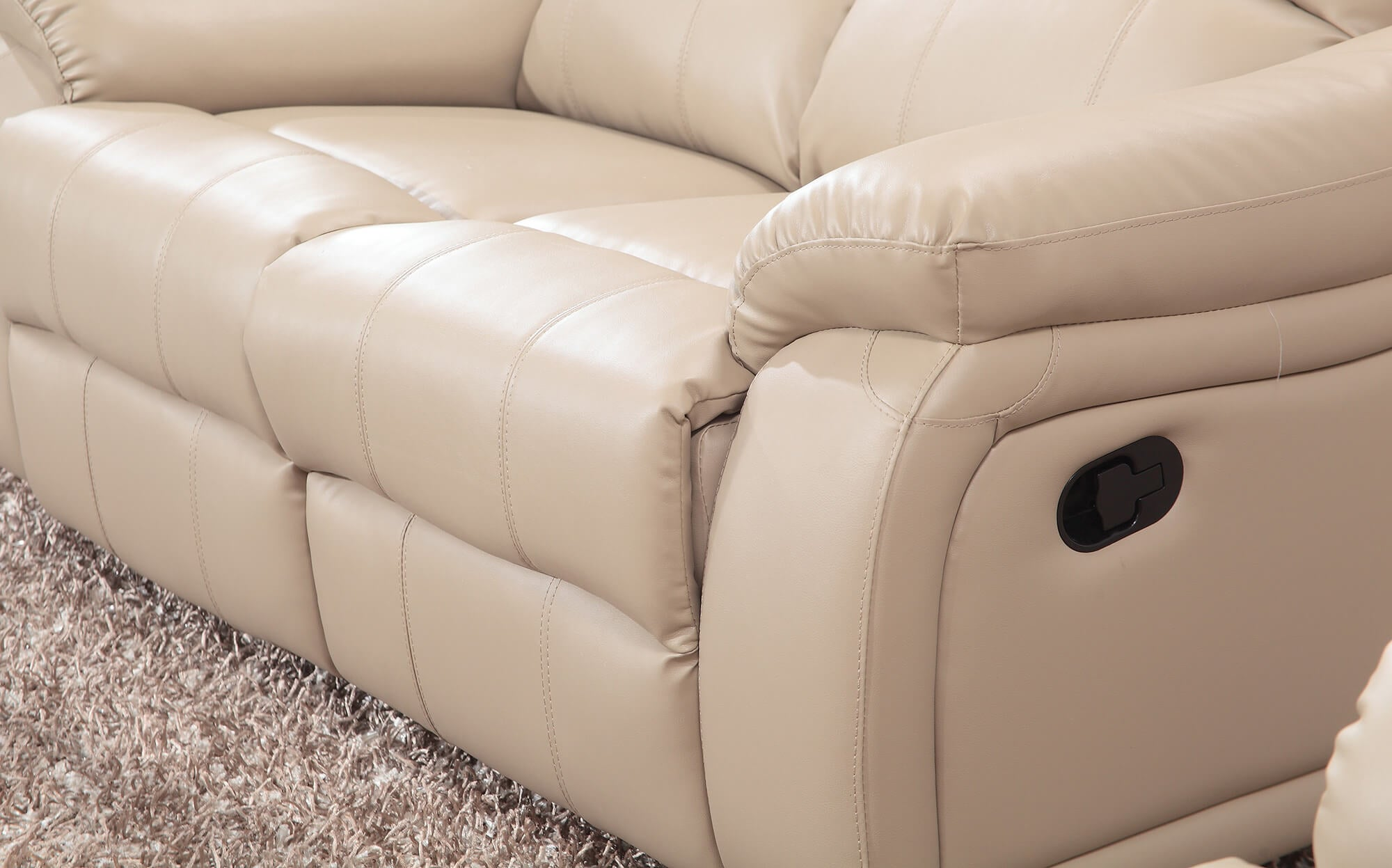 cream leather manual recliner sofa closeup