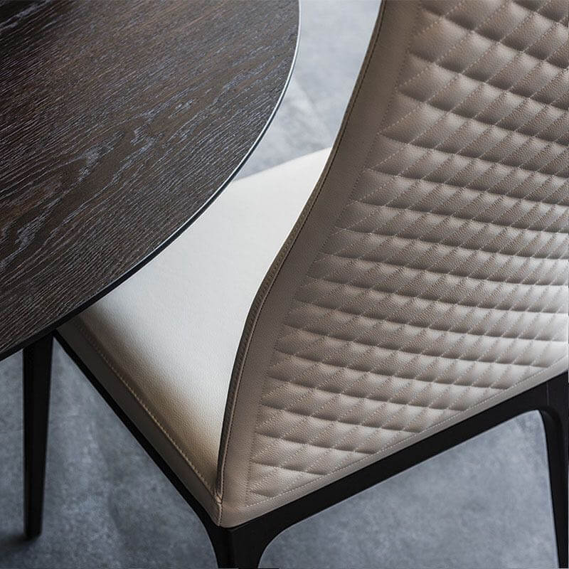 cream quilted pvc leather dining chair close up