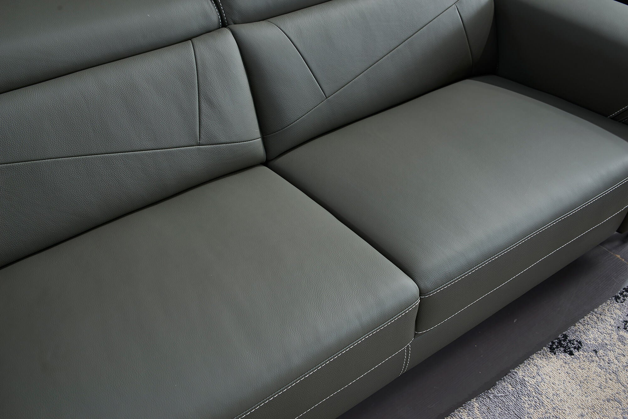 grey leather electric recliner 2 seater cushion closeup
