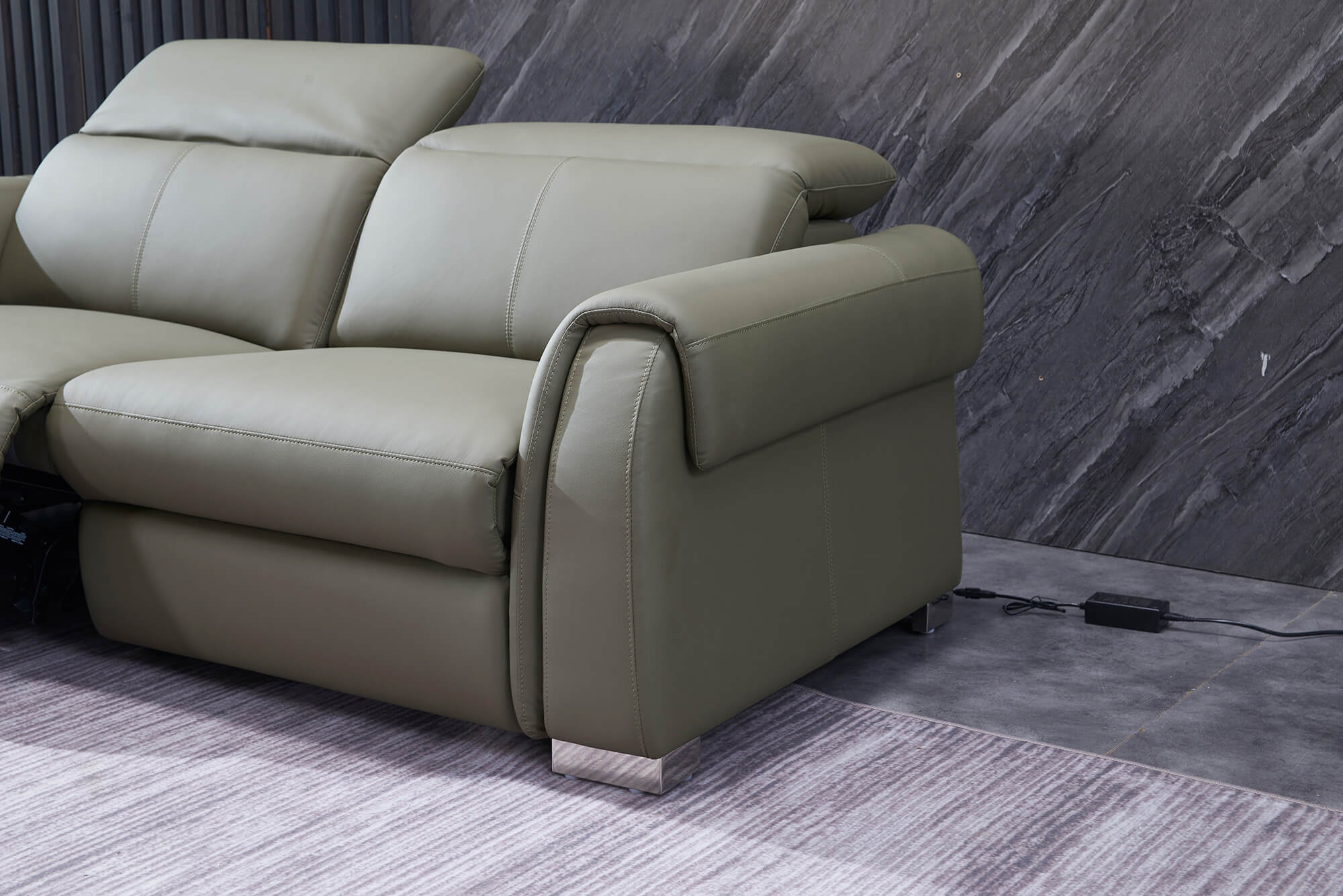 olive leather electric recliner sofa 2 seater reclined closeup