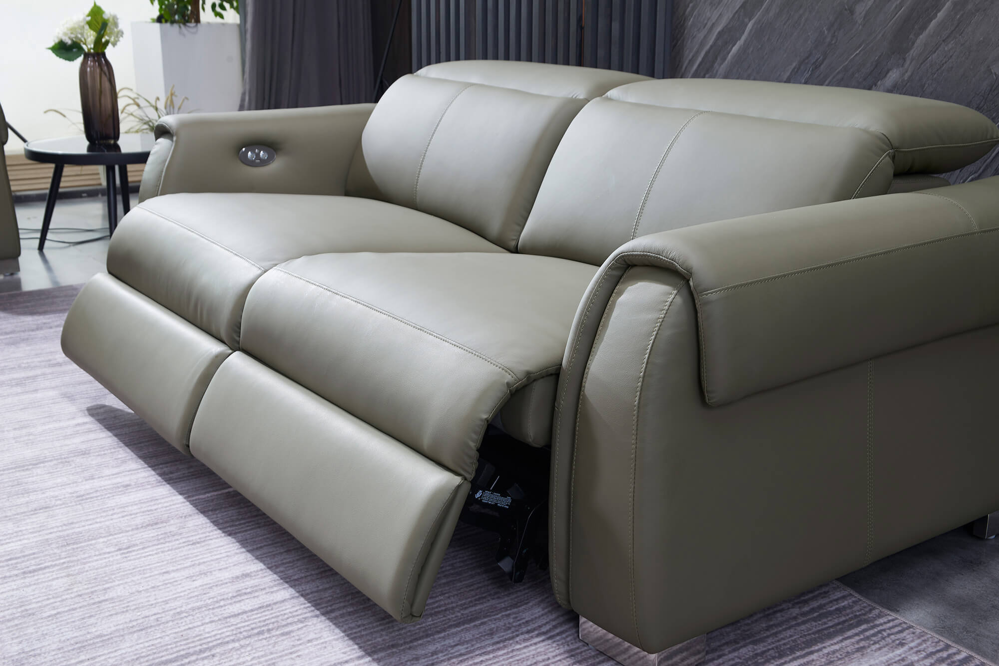 olive leather electric recliner sofa 2 seater reclined headrest back