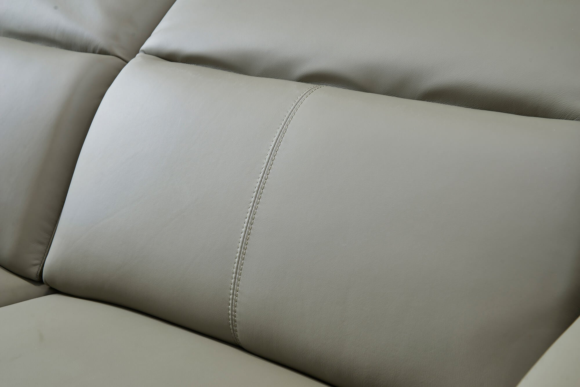 olive leather electric recliner sofa closeup