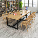 solid wood dining table in conference room setting