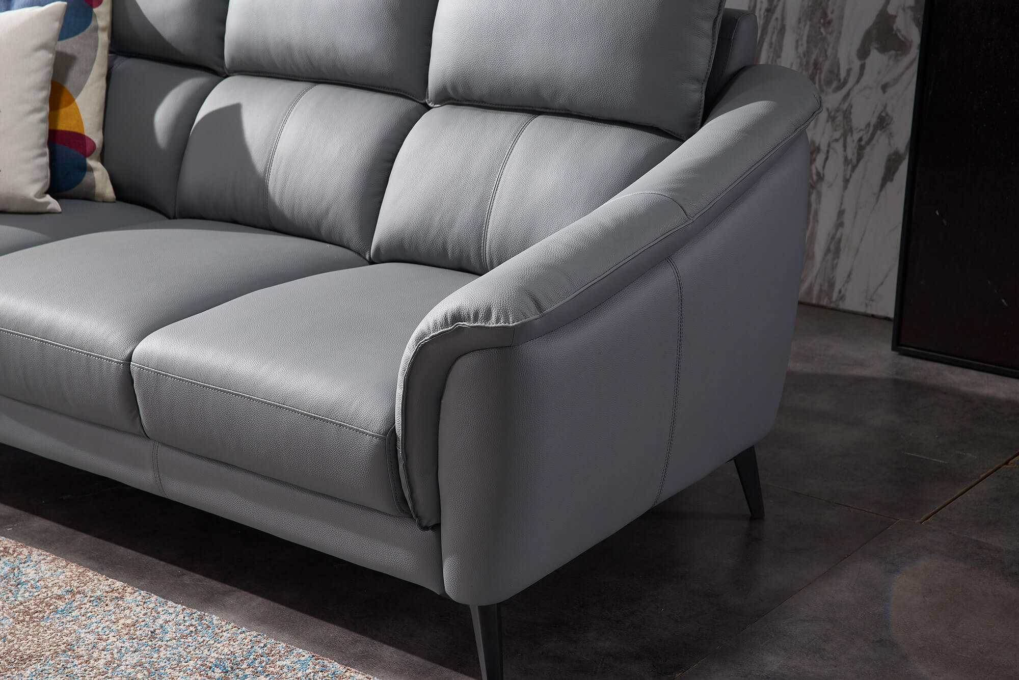 steel grey leather three seater sofa side view