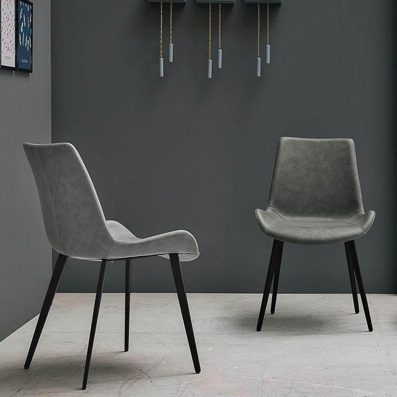two grey scoop dining chairs with metal feet