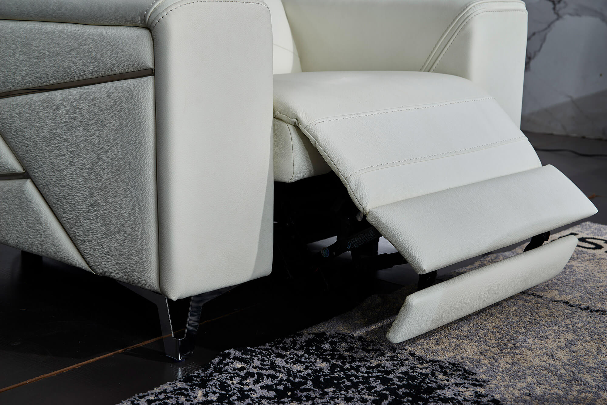 white leather electric recliner chair closeup