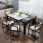 white marble top extendable dining table with dining chairs
