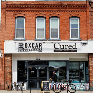 Boxcar Coffee Roasters cafe outside with person walking in