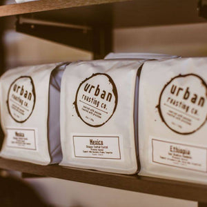 Bags of coffee on a shelf at Urban Steam