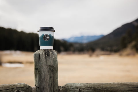 Lost coffee cup with mountains in the background