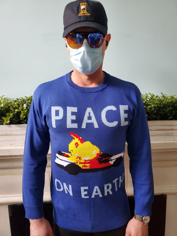 THE COLA CORPORATION PEACE ON EARTH SWEATER SHOWS A POLICE CRUISER ON FIRE