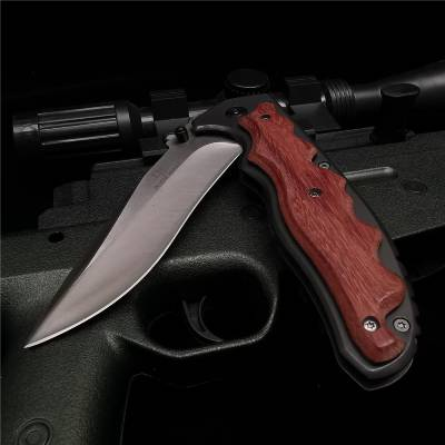 half folded red handle folding camping knife