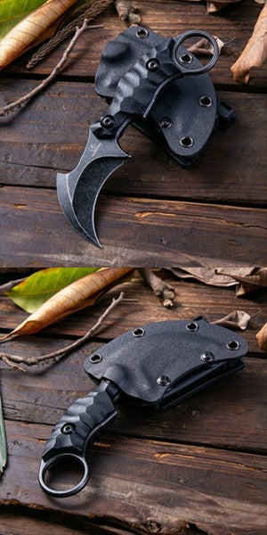 hunting claw knife karambit with holster holder on wooden table