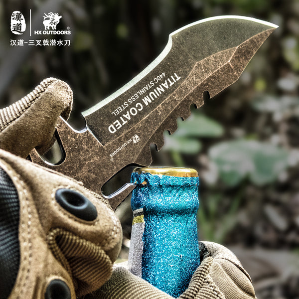 wear resistant survival knife used as a bottle opener