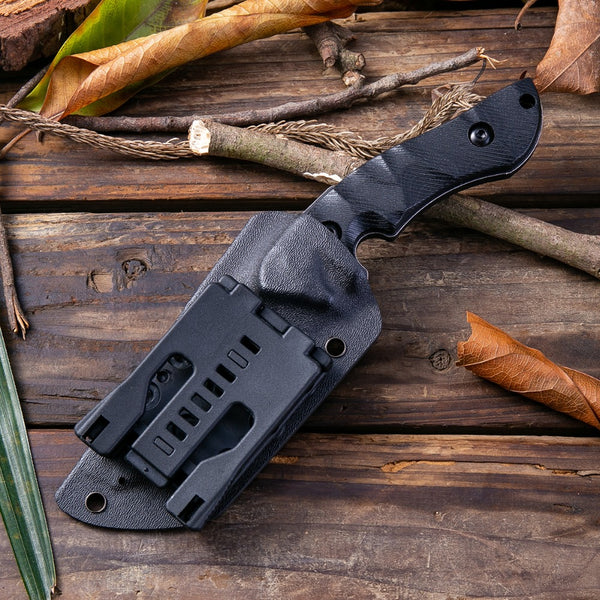 Holstered black stone wash hunting knife