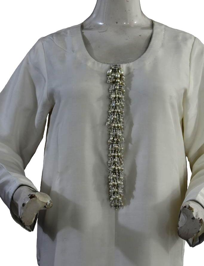 White Silk Suit with Pearl Buttons