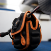 Black and orange spinning reel protective case