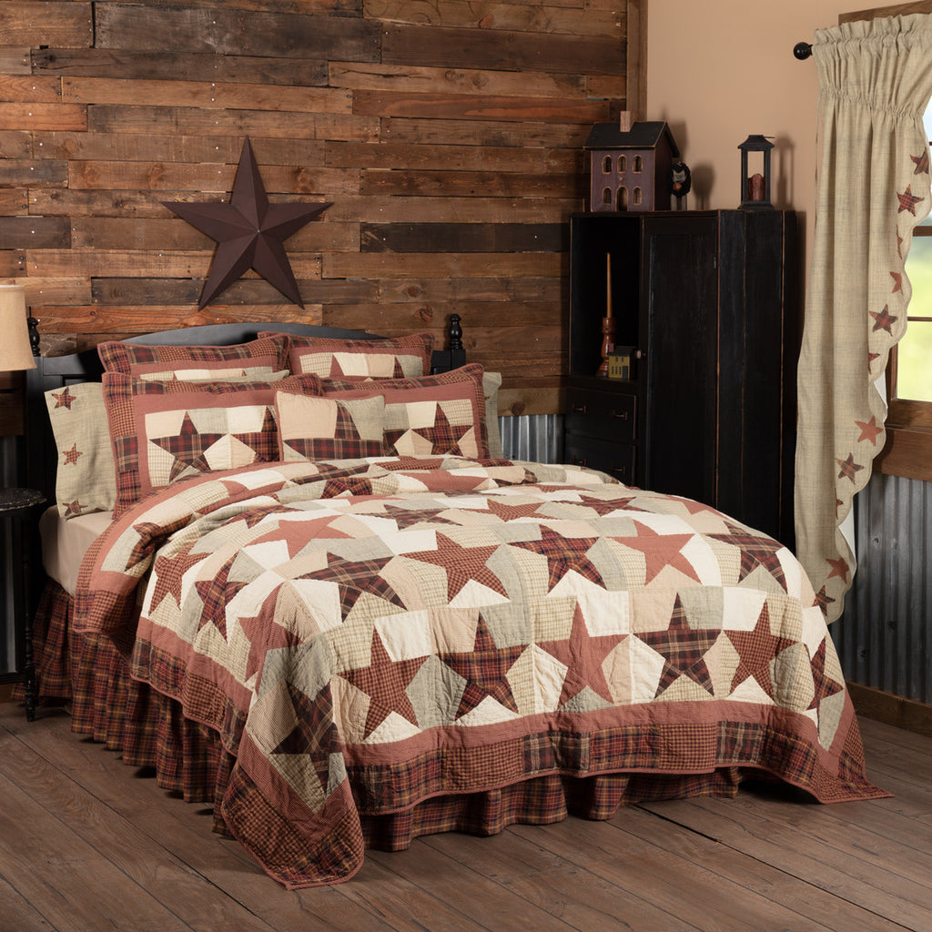Abilene Star patchwork quilted bedding collection features burgundy, brown and tan barn stars.