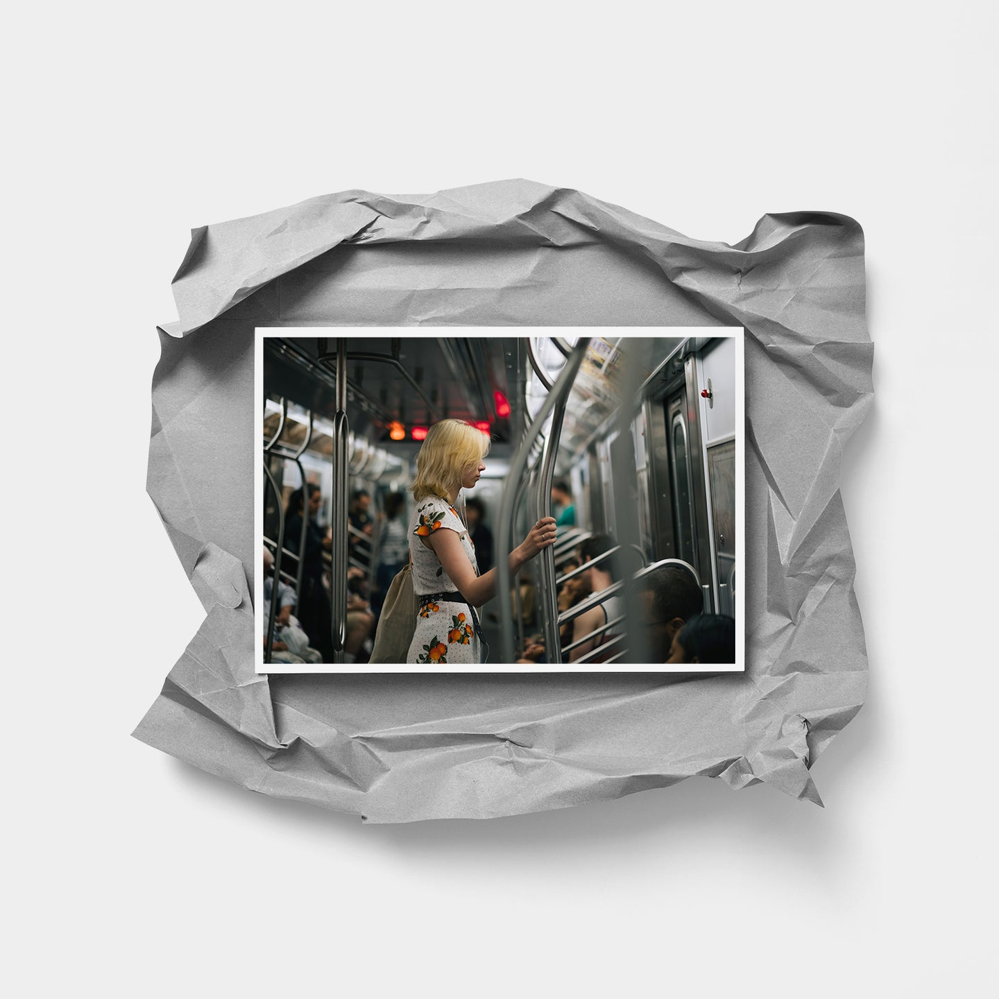 Photograph of a lady on the New York City subway.