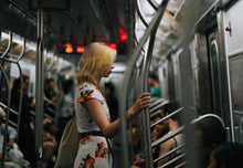 Load image into Gallery viewer, Photograph of a lady on the New York City subway.