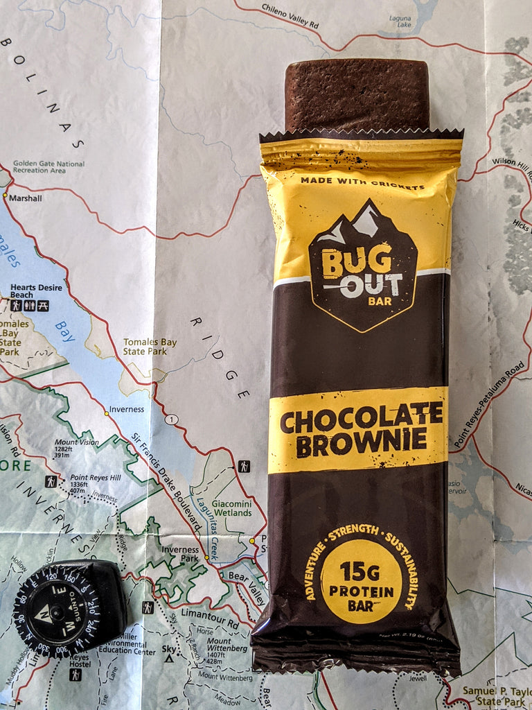 Cricket protein bar on a hiking trail map