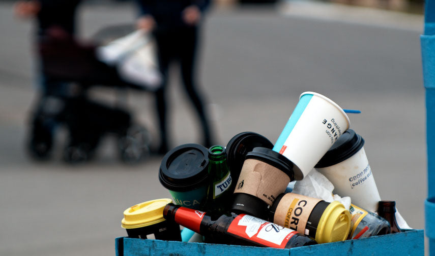 Disposable coffee cups in the trash
