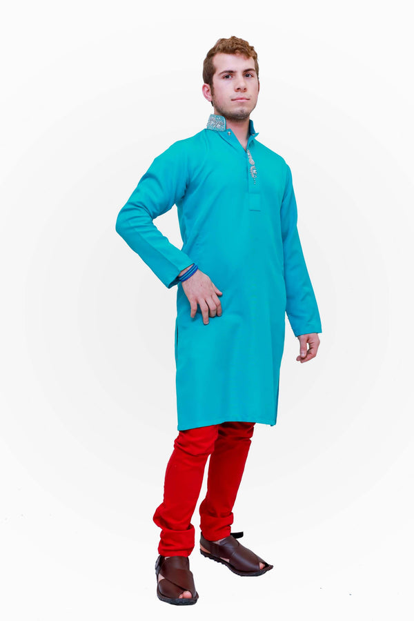 A cotton turquoise blue shirt with silver embroidery around the neckline
