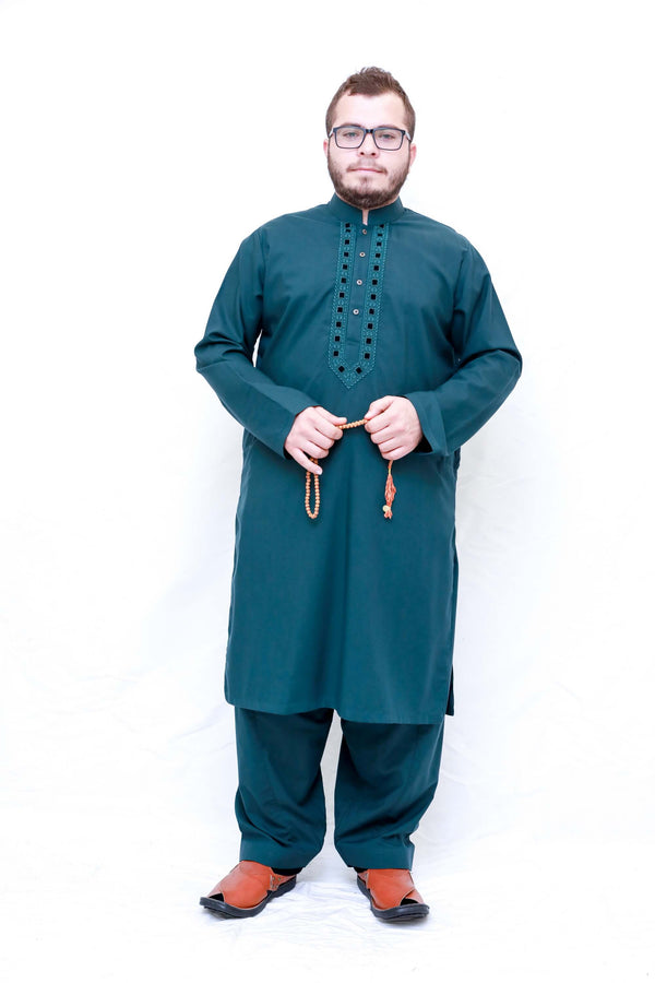 A dark green shirt with minimal embroidery in the same color and loose dark green pants. Men Green Cotton Salwar Kameez