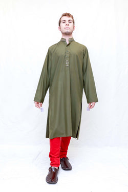 A green cotton shirt with tan embroidery around the neckline