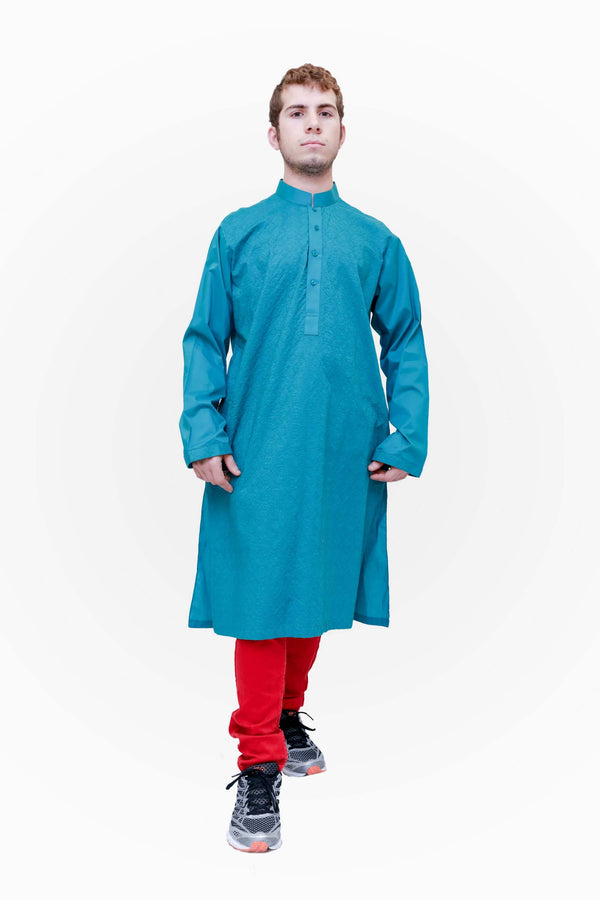 A blue cotton shirt with detailed embroidery covering the body of the shirt and the cuffs of the sleeves.