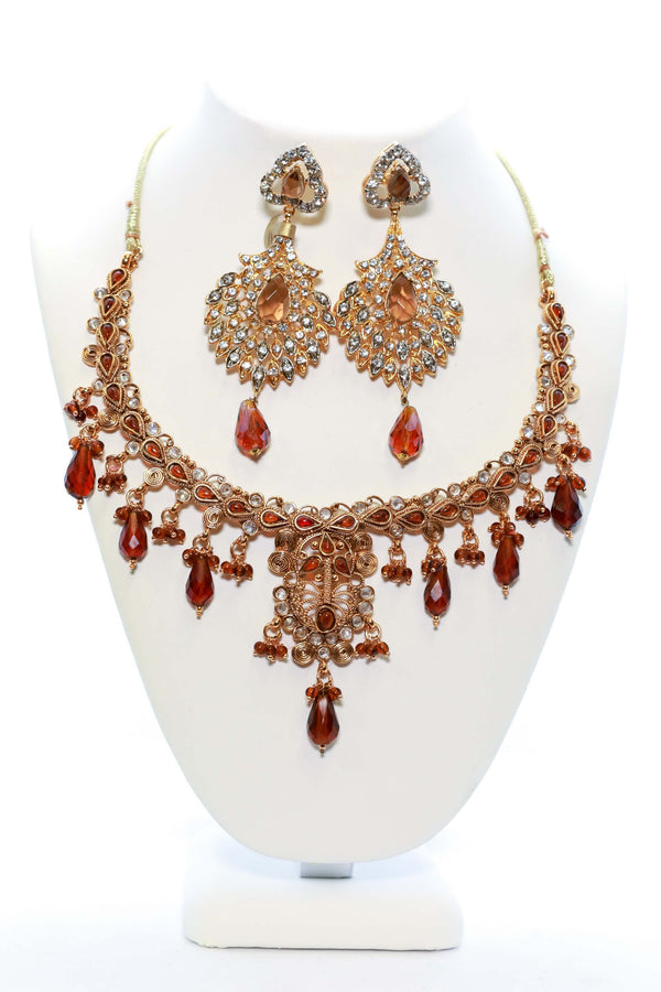 Golden Necklace and Earring Set with Red Stones - Trendz & Traditionz Boutique