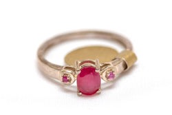 Golden Ring with Red Center Stone