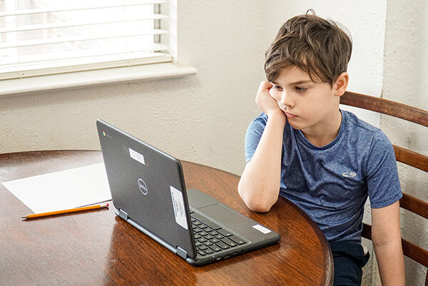 A boy is staring at the computer